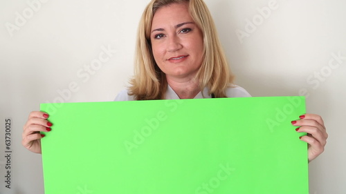 Woman Holding Onto A Green Screen