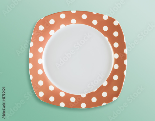 Retro style polka dot empty square plate top view