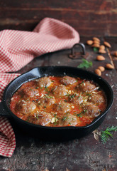 Traditional meatballs with tomato sauce, almond nuts