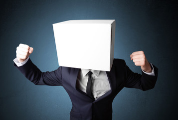 Businessman gesturing with a cardboard box on his head