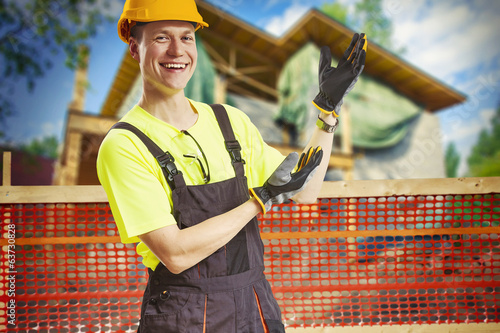 Smiling construction worker showing work in progress