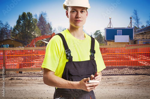 Construction worker takes notes from client