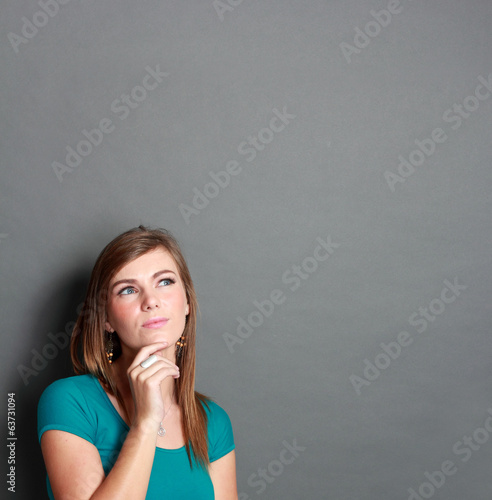 girl looking up to blank space