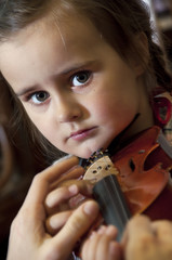 adorable little girl learning violin playing