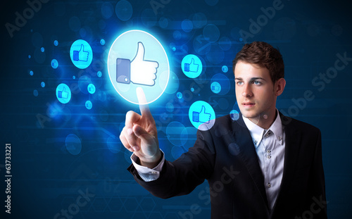 Handsome person pressing thumbs up button on modern social netwo