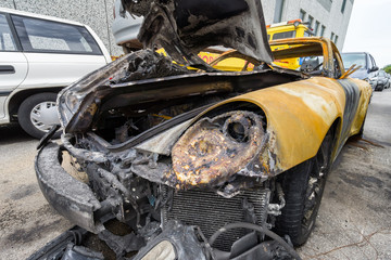 yellow sport car crashed and burned