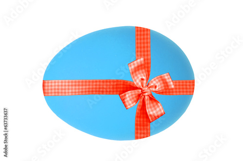Blue Easter egg with red ribbon and bow isolated on white