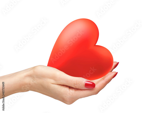 Red heart in woman hands isolated on white background