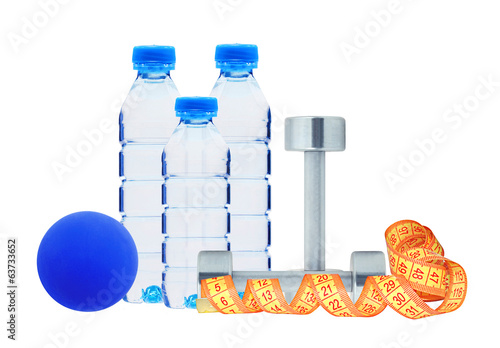 Blue bottles with water, dumbbell and ball isolated on white