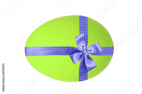 Easter egg with blue ribbon and bow isolated on white