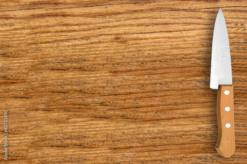 knife on cutting board isolated on white background
