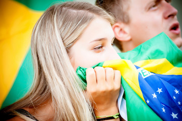 sad brazilian supporters at stadium