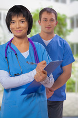 portrait of a medical team on a background of blurred hospital