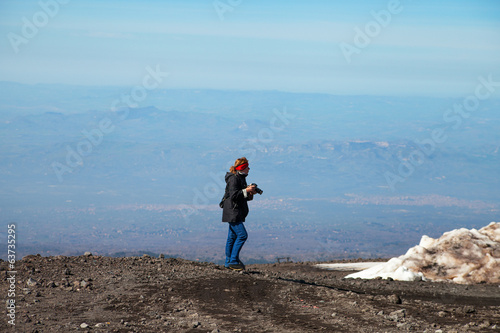 Photographer on mount Etna, Sicily.