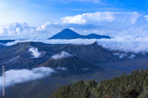 bromo and semeru mountain over the cloud