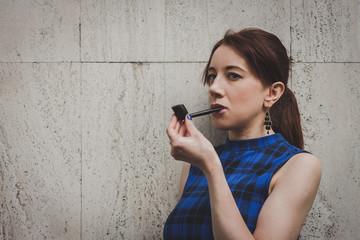 Pretty girl smoking vintage pipe