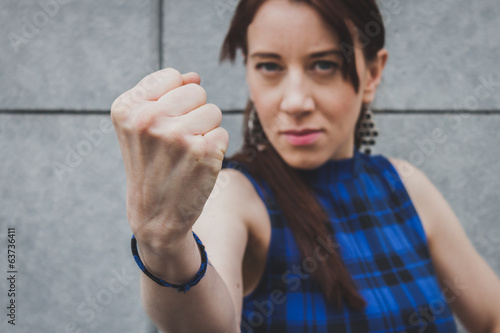 Pretty girl showing her fist