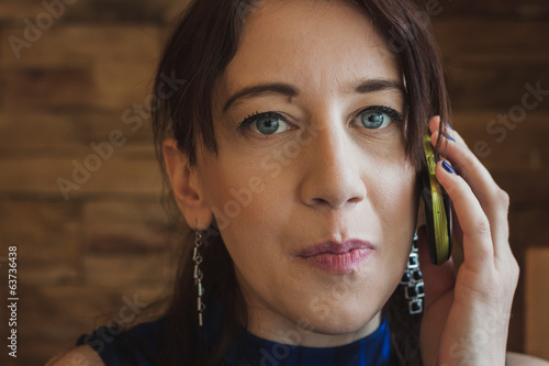 Closeup of a pretty girl talking on phone