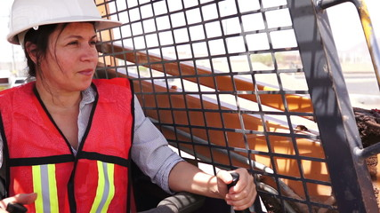 Industrial Female On Skid-steer Smile