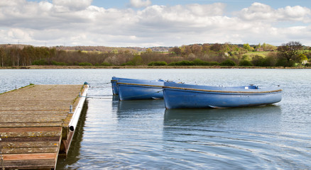 Small boats tied to a wooden jetty