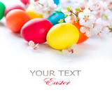Fototapety Easter. Colorful easter eggs with spring blossom flowers
