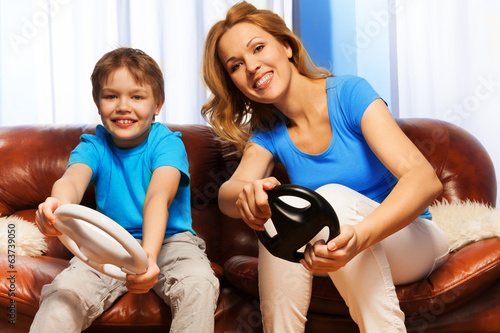Kid and mom driving steering wheels