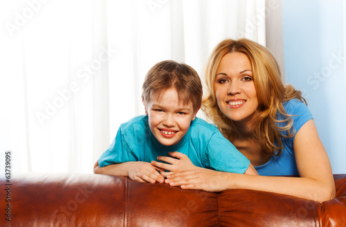 Smiling mother and laughing son cuddling