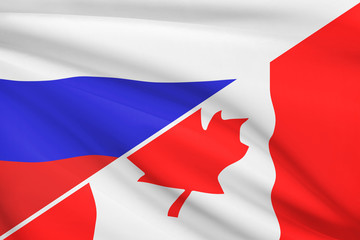 Series of ruffled flags. Russia and Canada