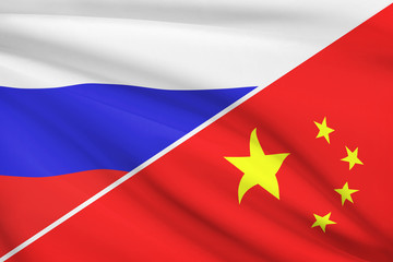 Series of ruffled flags. Russia and China.