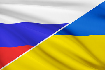 Series of ruffled flags. Russia and Ukraine.