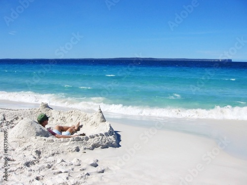 canvas print picture A man in his private sand castle