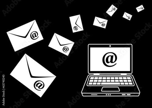 Laptop with envelopes on black background