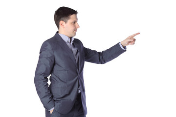 a young man in a gray suit pointing toward
