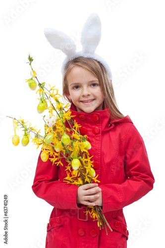 Little girl in spring clothes and flower branch