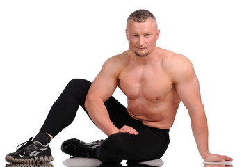 Muscular male body on white background