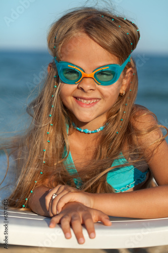 Little girl with swimming goggles