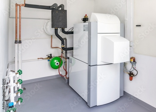A boiler room with a heating oil warm water system and pipes - 63741698