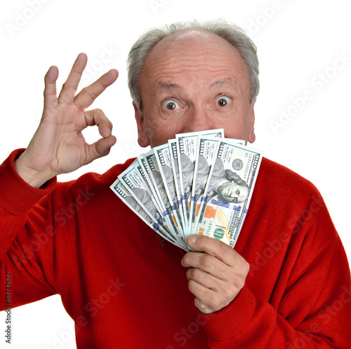 Happy elderly man holding dollar bills