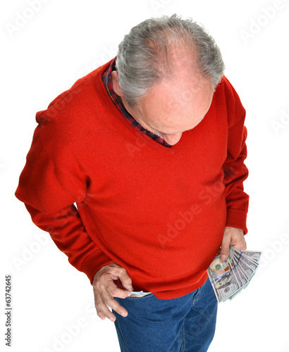 Man getting dollar bills from the pocket