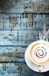 Coffee cup on vintage wood background