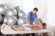 canvas print picture - manual therapy - physiotherapist working with pateint's arm