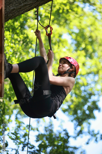 canvas print picture attractive woman climbing in adventure rope park