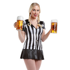 sexy woman in soccer referee clothes with a glass of beer