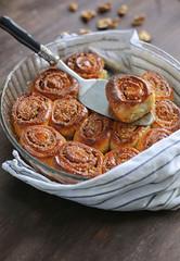 warm cinnamon rolls and nuts caramel sauce