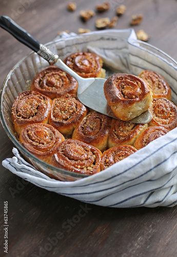 warm cinnamon rolls and nuts caramel sauce