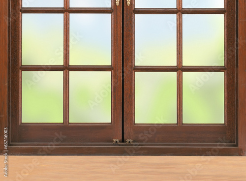 Wooden table and window and nature background