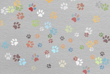 traces colored paws on paper texture, children funny background