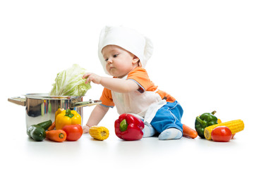baby chef with healthy  food vegetables and pan