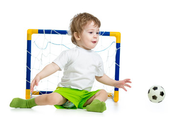 kid playing football and catching soccer ball