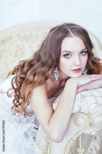 beautiful bride posing in antique sofa
